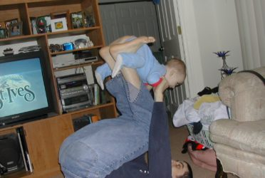Michael Doig playing with his son, Liam