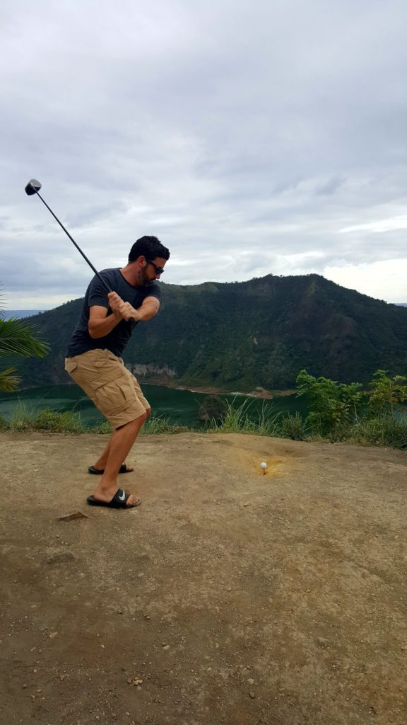 Hitting a golfball into Taal Volcano