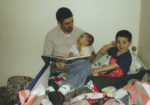 Michael Doig reading to his sons - Nevan and Liam