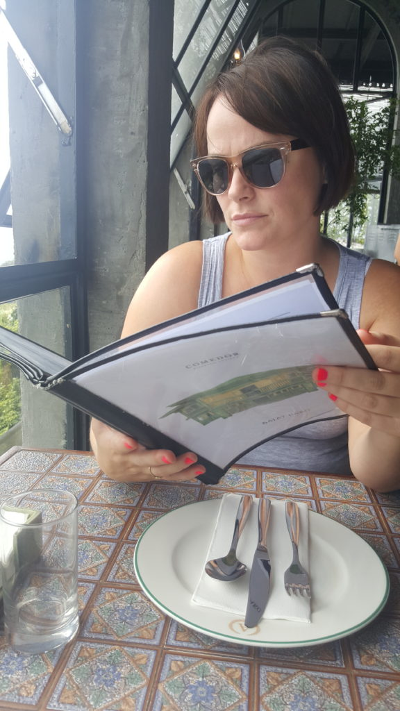 Louise Connolly deciding what to eat in the Philippines