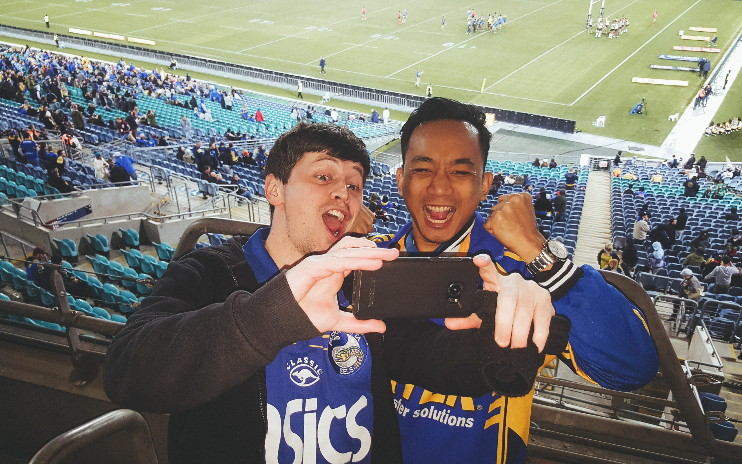 Louie Rosales and Gareth White cheer on the Parramatta Eels