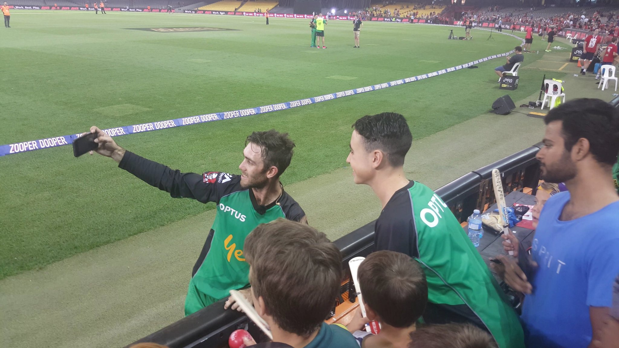 Glenn Maxwell takes a selfie with Liam Doig