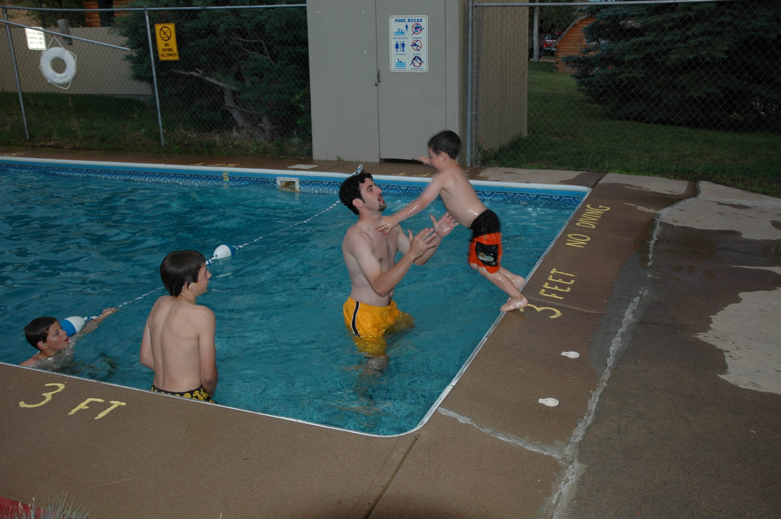 Northern Colorado Camping Trip - Michael and Nevan Doig pool fun