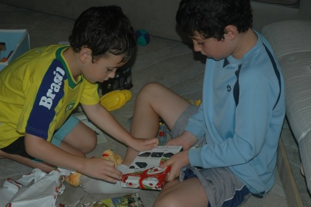 Hayden's First Christmas - Nevan and Liam unwrapping